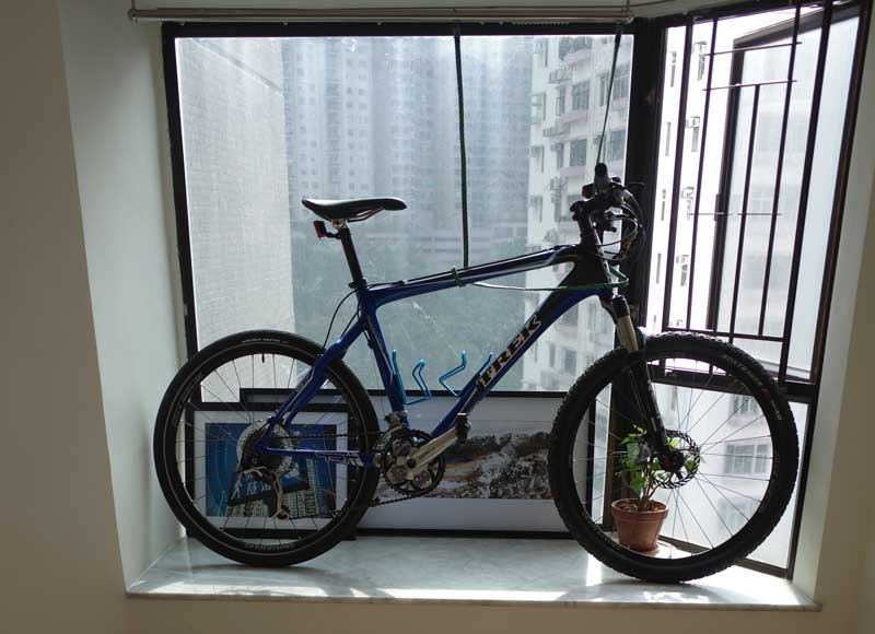 A bike kept in the window bay of a Hong Kong high-rise