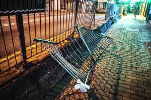 A twisted set of safety railings lie proped up on a pedestrian sidewalk on Caine Road, after a van smashed through and ploughed into a shop