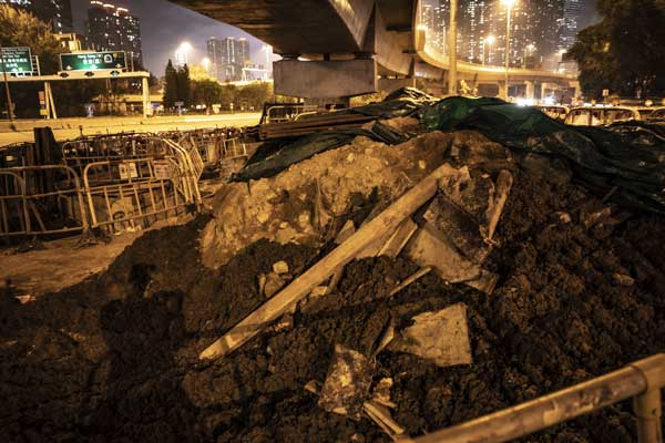 Uncovered construction waste lays in the open, creating dust issues in the nearby neighbourhoods