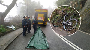 Local media showed the scene where a cyclist was killed by a collision with a goods vehicle on Peak Road this morning (photo: Apple Daily)