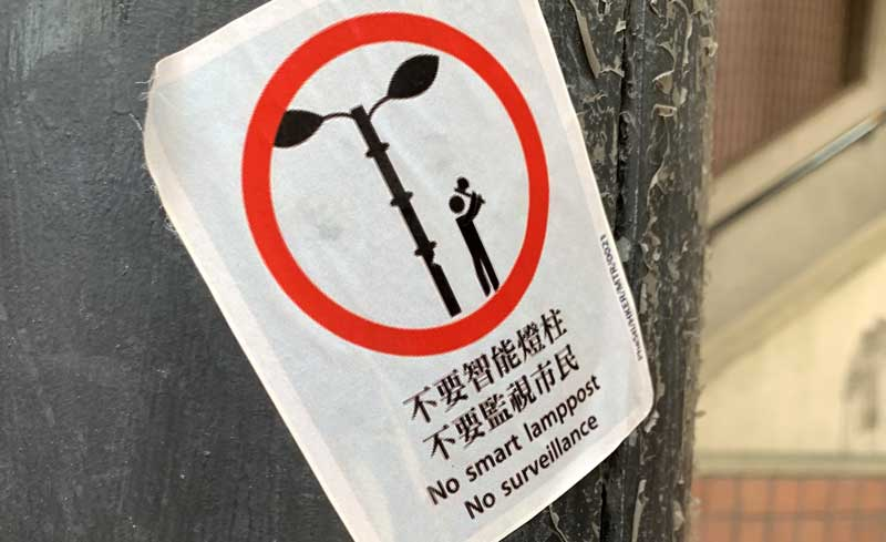 A protest sticker stuck to a Hong Kong lamppost decries the use of surveillance in Hong Kong's smart lampposts