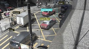 Screenshot of a police AI system which monitors traffic, and assigns values to each vehicle blocking a yellow-box junction- image shows vehicles tracked and boxed by the system
