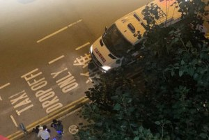 A police van from above, where an officer was working and attacked by someone throwing a rock