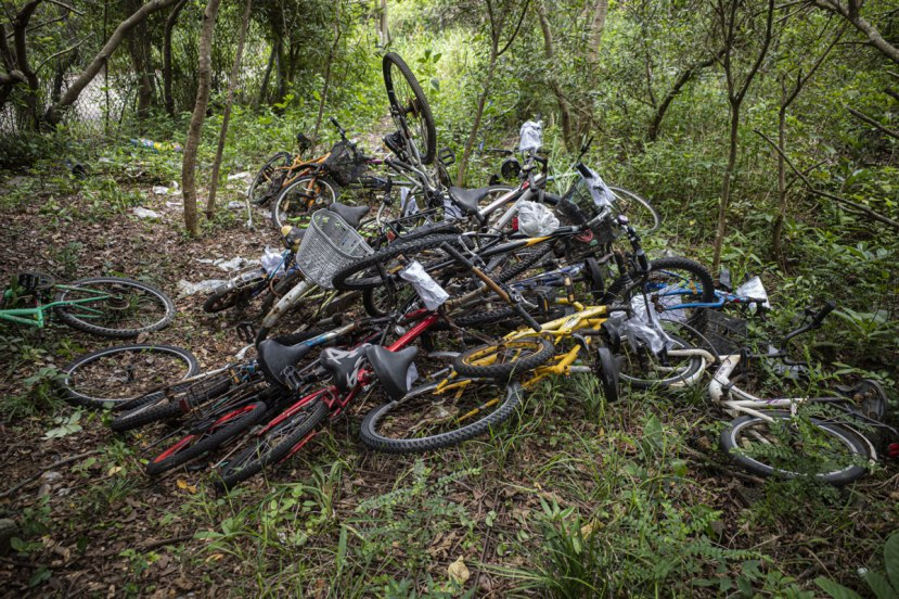 A pile of bikes dumped in a forest clearing on Lamma Island