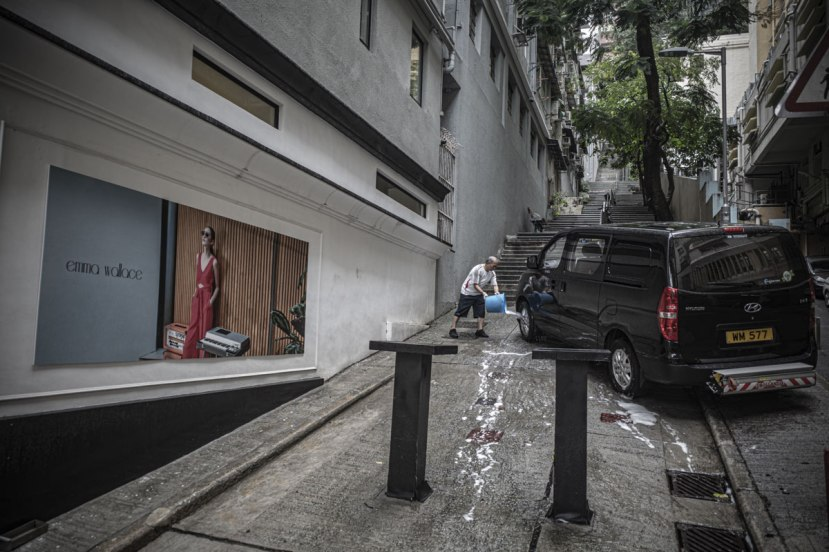 A van being washed on a footpath in Central Hong Kong