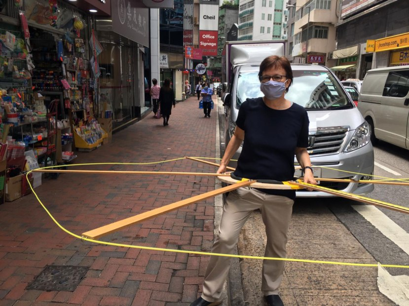 An activist wears the Social Distancing Machine in Hong Kong