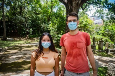 Alice Sze left and Fred Macias of Extinction Rebellion talk about air pollution in a Hong Kong cemetery