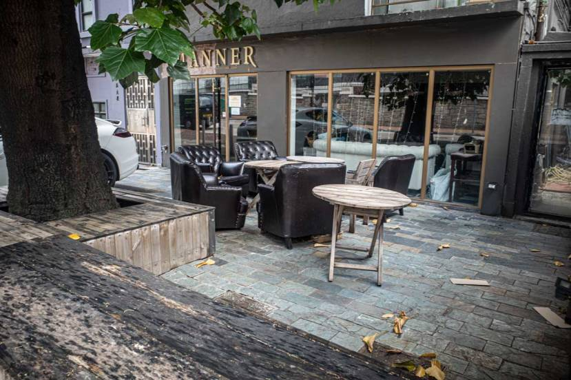 A coffee shop in Hong Kong, with outdoor seating in leather easy chairs