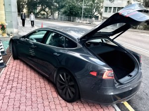 A Tesla S Uber blocks a pavement in Hong Kong with its trunk open